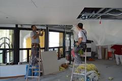 Installing plasterboard ceiling