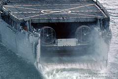 Ghost in The Machine (Vern Krutein) Tags: pareidolia military navy weapon naval weaponry usn amphibious helipad heliport landingpad unitedstatesnavy lcac armament landingcraftaircushion aircushionvessel ussfortfisherlsd40 mynv09p0419b anlcacwithaface wildermentofaface navalhovercraft