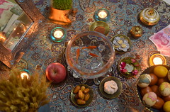 Happy Iranian new year! Norouz haftsin table spread in China (Germán Vogel) Tags: asia westasia middleeastculture china norouz newyear celebration festivity festival tablespread haftsin haftseen tradition culture spring equinox mirror money apple circle goldfish fish textile weaving candlelight candle travel handicraft artisan cozy warm symbol garlic paintedeggs persian persianculture synchretism eclecticism