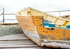 The Old Boat (Karen_Chappell) Tags: boat old weathered rural nfld newfoundland pouchcove yellow fence canada avalonpeninsula atlanticcanada slipway wood wooden paint painted blue