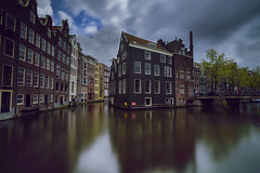 Corners of Amsterdam... (elpitiuso) Tags: longexposure amsterdam canals reflexes sky