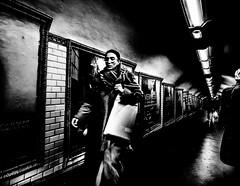 ElegantRush.jpg (Klaus Ressmann) Tags: klaus ressmann omd em1 fparis france peoplestreet subway winter blackandwhite candid contrast corridor elegant flcpeop poster streetphotography unposed woman klausressmann omdem1