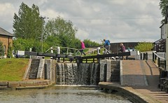 Overflowing lock (Vee living life to the full) Tags: shootaboot1 2015 thethreelocks canal grandunion locks barge narrowboat sailing overflowing plants speedwel nettle people crossing unlocking cabin throwing rope bargee bedfordshire buckinghamshire nikond300 parking mooring water still