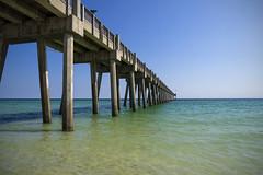 Pensacola Beach Pier (DJ Wolfman) Tags: pensacola pensacolafl pensacolabeach pier blue water green ocean atlanticocean oceanpiers olympus olympusomd em1markii 12100mmf4zuiko zuiko zd micro43
