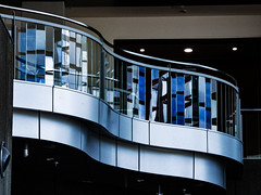 Curved Architecture (Steve Taylor (Photography)) Tags: curving curvy balcony christchurchartgallery art architecture light black blue monocolor monocolour white glass metal newzealand nz southisland canterbury christchurch city curve lines reflection rail railing