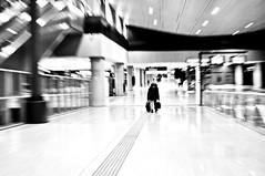in a hurry... (eggii) Tags: bw mono man zoom railwaystation lodz
