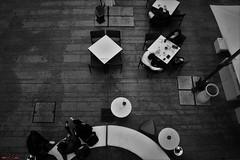 Pausa (rossoz) Tags: sardegna sardinia cagliari italy italia bar mem mediatecadelmediterraneo cafe bw above alto tavolini tables pausa pause relax