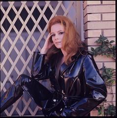Luciana Paluzzi in vinyl coat and pants (PVC Fashion) Tags: luciana paluzzi black shiny sexy pvc vinyl plastic coat mackintosh jacket pants trousers 1960s fashion clothing beauty celebrity celebrities women actress