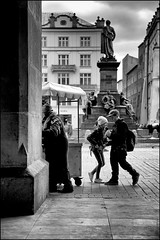 Photographs And Memories. (Mroovac) Tags: sukiennice mainsquare kraków cracow poland polska kids children oldtown childhood adammickiewiczmonument monument mickiewicz blackandwhite bw people street streetphotography canon6d canonef24105mmf4lis 2017