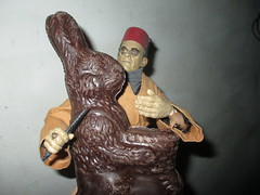 Ardeth Bey / Imhotep the Mummy holding Easter Bunny Rabbit hostage 2017 NYC 4605 (Brechtbug) Tags: boris karloff ardeth bey imhotep mummy holding easter bunny rabbit hostage 2017 monster dusty action figure universal monsters new york city egypt egyptian pharaoh bandage wrapping wrapped ash covered ancient antediluvian archeology museum excavation pyramid sphinx tomb dig sand desert creature its alive scary horror terror halloween fright toy toys shadow twist corpse case mummies sarcophagus sideshow chocolate eeeaster
