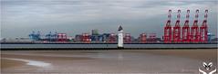 Cranes (Rebecca A. Anthony) Tags: liverpol docks bootledocks cranes lighthouse newbrighton wallasey
