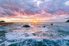 Remnants of the Storm Surge (-TommyTsutsui- [nextBlessing]) Tags: blue light sunset sea sky orange sun seascape nature rock japan clouds landscape spring nikon surf waves purple scenic      izu   410  matsuzaki sigma1020   onsalegettyimages
