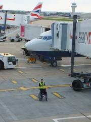 Gatwick Arrival (stevenbrandist) Tags: uk blue red white tarmac plane airplane airport aircraft wheelchair apron britishairways essex hsbc gatwick tailfin hiviz airbridge airside