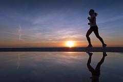 Kick Start the Day (Fotomondeo) Tags: morning sea españa sun sol mañana beach valencia sunrise reflections mar spain playa alicante amanecer runner corredor reflejos salidadelsol lx7 playadesanjuan lumixlx7 panasoniclumixlx7