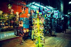 Nose Wipe (Tin V) Tags: street travel woman colour shop night mexico photography lights nikon df playadelcarmen vendor lantern 20mm f56 rivieramaya akumal quintanaroo tienvu cosinavoigtlandercolorskopar20mm
