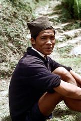 21-247 (ndpa / s. lundeen, archivist) Tags: nepal portrait people man color film face hat rural 35mm village 21 nick fez nepalese 1970s 1972 himalayas youngman villager nepali dewolf mountainvillage ruralvillage nickdewolf photographbynickdewolf ruralnepal reel21 hillyregion