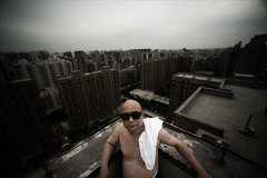 Beijing 1 (Jonathan Kos-Read) Tags: china roof rooftop sunglasses dark delete2 cool cityscape beijing save3 delete3 save7 save8 delete save save2 dirty save9 save4 save5 choice save10 uncool save6 barechest cool2 cool5 cool3 cool4 savedbythedeltemeuncensoredgrou uncool2 uncool3 uncool4 uncool5 uncool6 uncool7