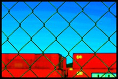 Barbed wired fence (mare_maris (very slow)) Tags: blue red green metal fence photo rust image geometry shapes line chain photograph barbedwire geometrical boundaries containers keepout parallelogram rustedmetal straightline againstthesky allrightsreserved redcontainers againstthe barbedsky workingwithshapes linesshapesandlines barbedcolors geometryandcolors keepingothersout keepingmein