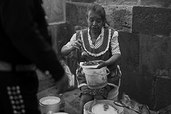a mariachi's lunch (BW version) (camelot98.) Tags: street leica city travel urban bw food woman monochrome mexico candid streetphotography sanmigueldeallende mariachi guanajuato summilux m9