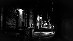 Noir (BeyondThePrism) Tags: filmnoir noir noiretblanc blackandwhite blackwhite black blacks dark light alley alleyway beyondtheprism wwwbeyondtheprismcom beyond prism darkness deep darkened spot lights lighting post lightpost castonguay vancouver vancouverstreets street streetphotography streets westcoast westcanada evening night later midnight outside outdoor outdoors people smoking smoke break shadow shadows structure digital d600 gritty jpcastonguay jeanphilippecastonguay jpc large canada clarity contrast vignette vignetting vanishing bw britishcolumbia nikon nikond600 nb m
