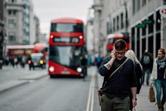 Man vs. Bus (Panda1339) Tags: zeissaposonnart2135 streetphotography nikondf cinematic london uk blur man bus route 73 oxford street zeiss bokeh red aposonnart2135 zf2 people cyclist carlzeiss