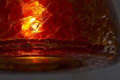 Textured Glaze (brucetopher) Tags: macromondays glaze orange pendant light lighting texture glass mood glow macro