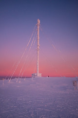 Top of Yllas in glow (Janne Räkköläinen) Tags: yllas lapp lappi lappland winter mast electricmast radiomasto sun sunset glow snow photo mountain december finland suomi