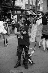 (namroff) Tags: sxsw sxsw2017 austin austintx atx street streetphotography candid people bw blackandwhite 6thstreet man panhandler pirate piratecostume cardboardsign nateforman namroff nikon nikond810