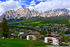 Cortina d'Ampezzo with Pomagagnon Mountains, Dolomites, Italy (GSB Photography) Tags: italy dolomites veneto cortina cortinadampezzo village town pomagagnon mountain cristallogroup mountains peaks greaterdolomitesroad wintersports bolteriver serene serenity clouds snow rocks rugged range trees pasture forest foothills tectonic tilt geology geography erosion reversefault iphone gsb