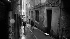 wet day (byronv2) Tags: edinburgh edimbourg scotland blackandwhite blackwhite bw monochrome street candid peoplewatching oldtown dusk fleshmarketclose close alley weather wet raining rain cockburnstreet perspective