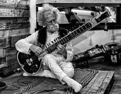 """ A sitar player, lots of vibrations. "" (pigianca) Tags: italy siena biovitaristorante portrait monochrome blackwhite leicam240 voigtlandernokton35mmf14"
