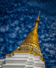 Wat Chiang Yuen (Carl's Captures) Tags: cityscape culture history wat temple steeple spire architecture buddhism religion faith belief worship gold blueskies clouds chiangmaithailand siam asia pagoda nikond5100 tamron18270 lightroom5 photoshopbyfehlfarben thanksbine seeyouonthepierxoxo