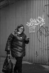 DR151210_0955D (dmitry_ryzhkov) Tags: wall phone glasses day daylight motion movement walk walker walkers pedestrian pedestrians sidewalk woman women lady one art city europe russia moscow documentary journalism street streets urban candid life streetlife citylife outdoor outdoors streetscene close scene streetshot image streetphotography candidphotography streetphoto candidphotos streetphotos moment light shadow people citizen resident inhabitant person portrait streetportrait candidportrait unposed public face faces eyes look looks