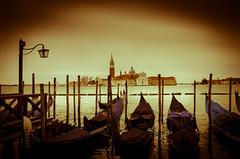 Venice under cloudy sky (Sean X. Liu) Tags: venice clouds gondola light lightpole vignette italy sea church