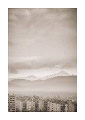 A Shared View (icypics) Tags: buildings landscape ljubljana mountains urban cloud hotel layering mist sepia slovenia