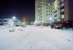 Katowice, Poland. (wojszyca) Tags: contax g2 zeiss biogon 21mm fuji fujichrome rtp t64 tungsten slide night longexposure city urban winter cold snow towerblock residential paderewa katowice