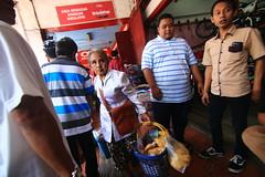 passionate granny (Syarafuddin) Tags: streetphotography older seller senior malioboro yogyakarta indonesia young woman people crowd face gesture