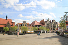 Solitude on the road (gráce) Tags: erfurt germany thuringia road cyclist street streetscape streetlife city cityscape cityview architecture buildings sky clouds wires roofs canon canoneos550d