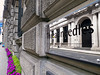 Reflection of Pacific Oriental (Kombizz) Tags: flowers building london architecture thecity lightgreen streetview cityoflondon blackdoor purpleflowers happyflowers threadneedlestreet 1050574 threadneedles kombizz reflectionofpacificoriental