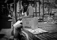 Thinking outside the box (lvaroGmez) Tags: street bw monochrome photography angle market candid 28mm wide ape sicily palermo 1030mm nikonv1