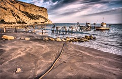 Zapalo Bay (Alexandros Constantinides) Tags: sea sky cliff beach water clouds boats bay sand cyprus rope kourion zapalo