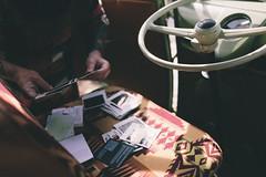 Sifting through the Polaroids (DearAbbie) Tags: travel vw 35mm volkswagen polaroid roadtrip canon5d polaroids steeringwheel vwvan 35l