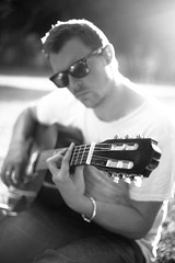 Music for the soul (Lara Cores) Tags: park light portrait bw music white man black guy london english love valencia monochrome canon 50mm glasses cool focus bokeh song cigarette smoke singer goodbye gentleman musicien guitarre laracores