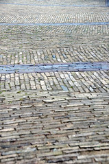 Cobbles (jonhaywooduk) Tags: amsterdam graffiti vespa pavement stickers ladybird cobbles lattice