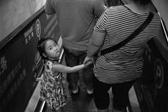 (JC.Murphy) Tags: china bw white black film shop zeiss kid child kodak 28mm trix escalator supermarket walmart mum parent xian stare ikon shaanxi