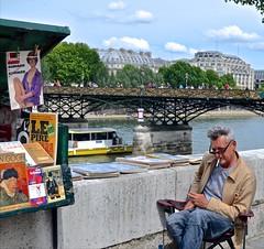 Left Bank livriste,  books, boats, and love  locks. (David McSpadden) Tags: paris france seine boat barge leftbank bookseller lovelocks liviriste