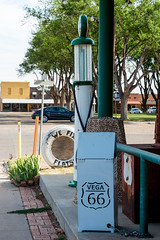 Historic Route 66 - Magnolia Service Station at Vega, Texas (MikePScott) Tags: road street camera usa sign buildings logo lens highway boulevard texas unitedstates motorway pavement flag garage banner gasstation sidewalk freeway magnolia avenue vega servicestation petrolstation builtenvironment architecturalfeatures historicroute66 nikond800 nikon28300mmf3556 featureslandmarks