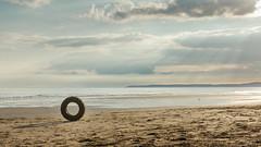Beach Ring (SJLens) Tags: sea sun beach water sunshine evening coast sand cornwall objects whitsandbay rays tyre whitsand summerevenings southwestengland cornishcoast freathy tregantle d7000