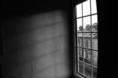 Only light can erase the dark (sophiealayna) Tags: lighting light shadow blackandwhite bw sun white black slr window monochrome contrast digital canon dark photography eos raw shadows darkness emotion interior room sophie files pane sunrays enlightenment simple plain highlight sunbeam beams alayna 1100d sophiealaynaphotography