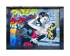 Street Art (Rich Simmons), South London, England. (Joseph O'Malley64) Tags: richsimmons streetart urbanart graffiti southlondon london england uk britain british greatbritain art artist artistry artwork mural muralist panels woodenpanels cladding tarmac urban urbanlandscape aerosol cans spray paint fujix accuracyprecision
